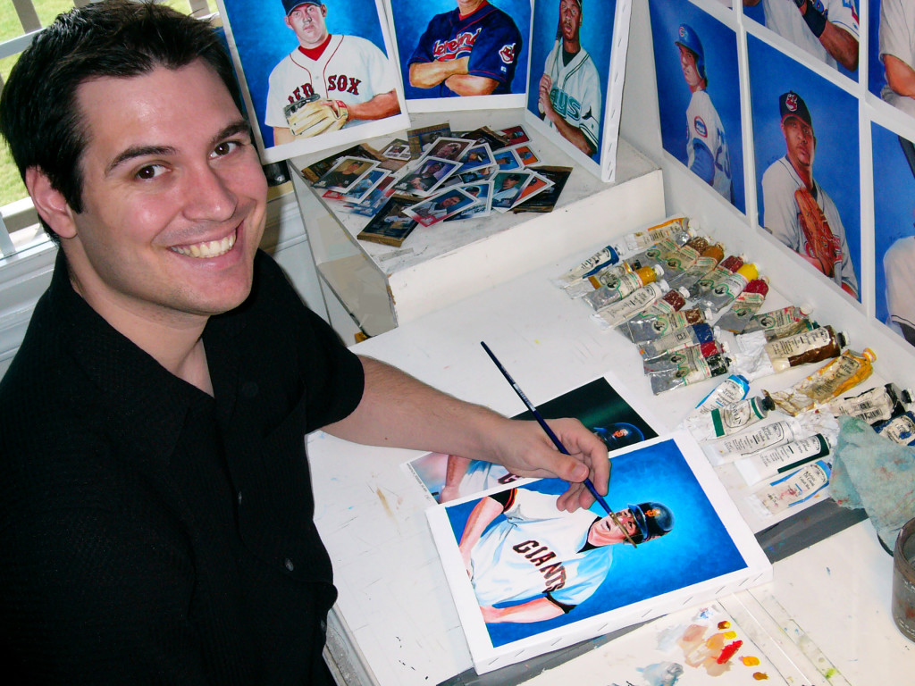 Artist Ben Teeter works on a painting in his studio.